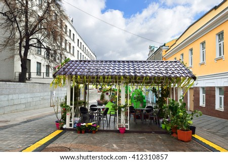 MOSCOW, RUSSIA - APRIL 23, 2016: Moscow Spring holiday. Cafe decorated with flowers in Stoleshnikov Lane