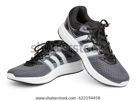 MOSCOW, RUSSIA - APRIL 7, 2017: Pair of new gray Adidas sport running shoes, sneakers or trainers isolated on white background with clipping path