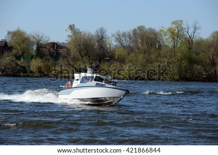 MOSCOW, RUSSIA - APRIL 25, 2014: Patrol boat on the river Moscow.