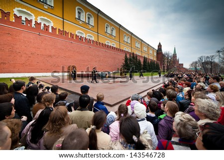 MOSCOW, RUSSIA - APRIL. 20: The people looking at changing of the guard at the Tomb of the Unknown Soldier at the Kremlin wall Moscow, Russia on April 20, 2013