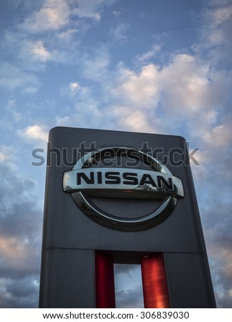 MOSCOW, RUSSIA - Aug 15, 2015: Nissan logo against evening sky. Nissan Motor Company Ltd is a multinational car manufacturer headquartered in Yokohama, Japan. - stock photo