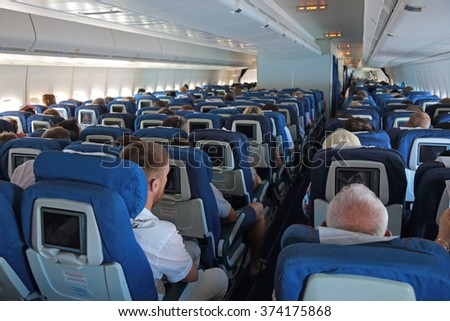 MOSCOW, RUSSIA - AUG 09, 2015: Passengers on board the aircraft Boeing-747, Russian airlines Transaero - stock photo
