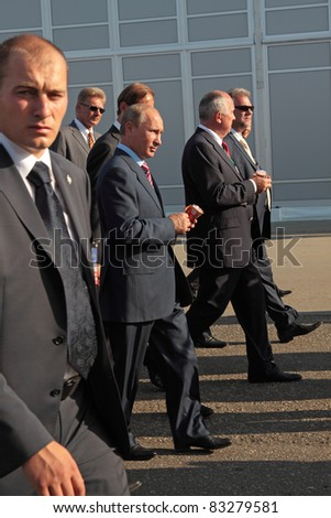 MOSCOW, RUSSIA - AUG 17: Vladimir Putin (C), Russian Prime Minister arrives at the International Aviation and Space salon MAKS on Aug 17, 2011 at Zhukovsky, Russia - stock photo