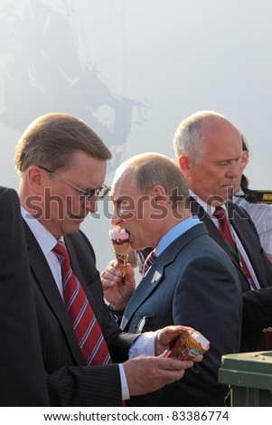 MOSCOW, RUSSIA - AUG 17: Vladimir Putin, Prime Minister and Sergei Ivanov secretary of the Security Council at the International Aviation and Space salon MAKS. Aug 17, 2011 at Zhukovsky, Russia - stock photo