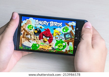 Moscow, Russia - August 26, 2014: Angry Birds computer game developed by Finnish company Rovio Entertainment first released in 2009. It sold over 2 billion copies across all platforms - stock photo