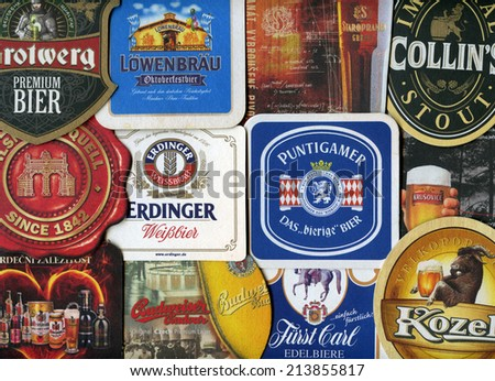 MOSCOW, RUSSIA - AUGUST 29, 2014: Beermats (bierdeckel) background. Various beer trademarks