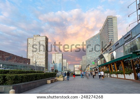 MOSCOW, RUSSIA - AUGUST 23, 2014: Buildings at New Arbat Street, in the rays of the evening sun. New Arbat is located in the central part of Moscow - stock photo