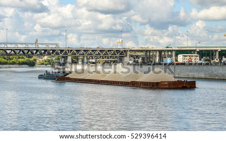 MOSCOW, RUSSIA - August 4, 2016. Cargo barge with gravel on Moscow-river