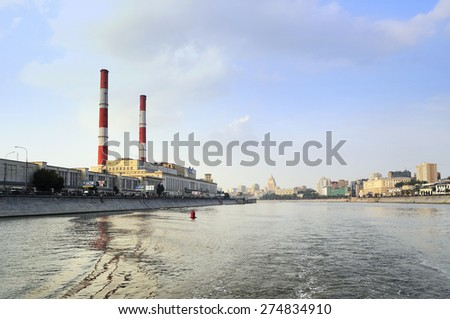 "MOSCOW, RUSSIA - AUGUST 15, 2012. Cityscape with TPP-12 of OAO ""Mosenergo"" and residential buildings along the waterfront"