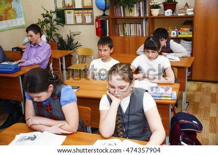 Moscow,Russia-August 16,2016-Little schoolboy sitting behind school desk during lesson in Russian school
