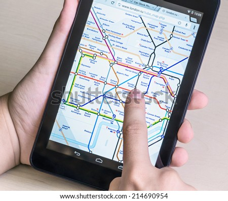 Moscow, Russia - August 26, 2014: London Underground diagram on the tablet. London Underground is one of the largest in the world, its network consists of 11 lines with a total length of 402 km. - stock photo