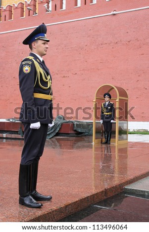 MOSCOW, RUSSIA - AUGUST 18: Military men guard the war memorial of the Kremlin, in August 18, 2012 in Moscow, Russia. Kremlin is an historic fortified complex at the heart of Moscow