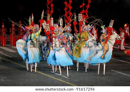 "MOSCOW, RUSSIA - AUGUST 31: Participants of the International Military Music Festival ""Spasskaya Tower"", the troupe from  She Huo Xi'an, China. August 31, 2011 on Red Square in Moscow, Russia - stock photo"