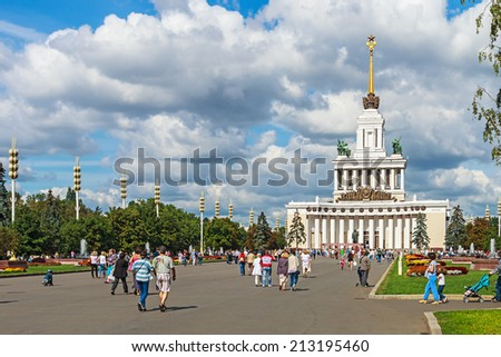 Moscow, Russia - August 23, 2014: people and tourists walking on Vystavka Achievements of National Economy in Moscow. Exhibition Complex was officially opened in 1939. - stock photo