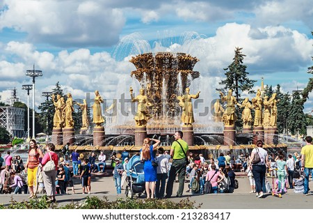 "Moscow, Russia - August 23, 2014: people vacationers and tourists from the ""Peoples Friendship fountain"" in VDNKh Exhibition Centre."