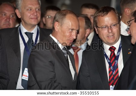 MOSCOW, RUSSIA - AUGUST,18: Prime Minister of Russia Vladimir Putin (c) at the International Aviation and Space salon MAKS,  August,18, 2009 at Zhukovsky, Russia