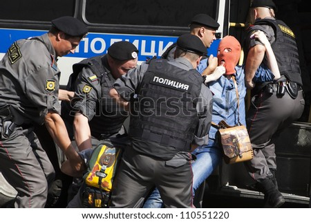MOSCOW , RUSSIA - AUGUST 17. Pussy Riot protester  wears balaclava arrested by police  outside court.  People  protest  and support  members of Pussy Riot feminist punk band on August 17, 2012, Moscow