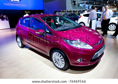 MOSCOW, RUSSIA - AUGUST 25:  Red car Ford Fiesta on display at Moscow International exhibition InterAuto on August 25, 2010 in Moscow, Russia. - stock photo