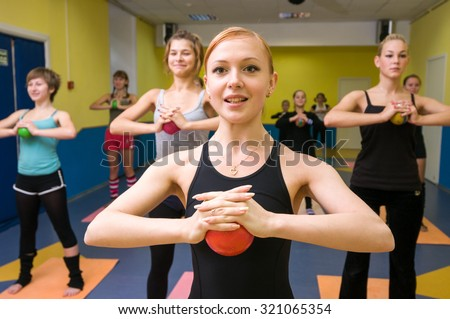 MOSCOW, RUSSIA - August 24, 2009 - Teenage girls exercising with yoga teacher instructor at the gym - stock photo