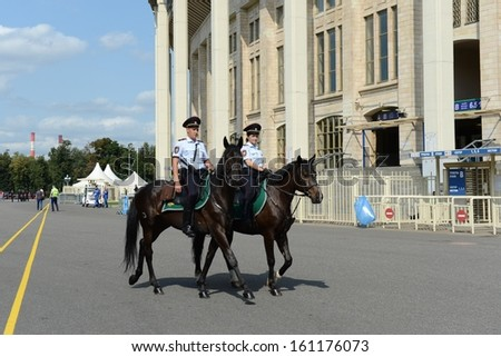 MOSCOW, RUSSIA - AUGUST 12: The largest unit of mounted police in Europe is located in Moscow. They safeguard public order. Mounted police patrol Moscow park in August 12,2013 in Moscow,Russia