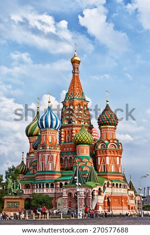 MOSCOW, RUSSIA - AUGUST 15, 2014: Tourists near St. Basil's Cathedral on Red Square.Red Square is central place and popular site in Moscow. - stock photo