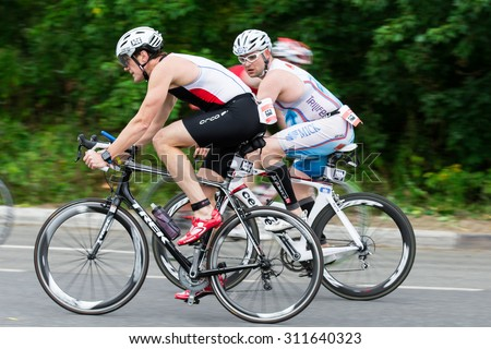 Moscow, Russia, August 16. Triathletes ride speed cycles during triathlon competition in Moscow, August 16, 2015 in Moscow, Russia