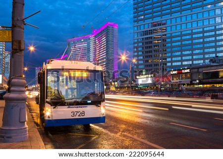 MOSCOW, RUSSIA - AUGUST 23, 2014: Trolleybus on New Arbat Street in evening. New Arbat is located in the central part of Moscow - stock photo