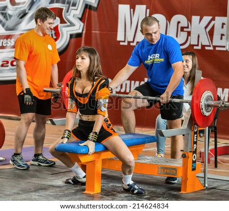 Moscow, Russia - August 23, 2014: Unidentified athlete in action during the 2014 world Cup powerlifting event in Moscow.
