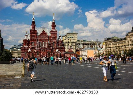 MOSCOW, RUSSIA - AUGUST 2, 2016: View of the Red Square in Moscow, Russia. Tourists walk on the Square. UNESCO World Heritage Site.