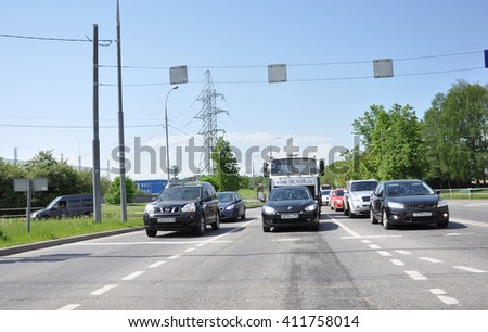 Moscow, Russia - 05.28.2015 - Cars stand at the traffic lights in Zelenograd
