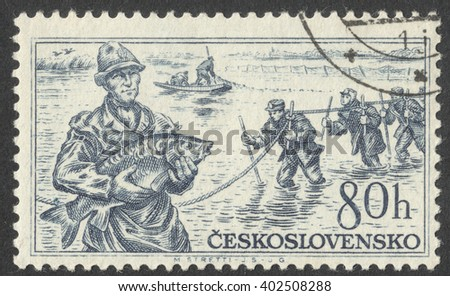 """MOSCOW, RUSSIA - CIRCA APRIL, 2016: a post stamp printed in CZECHOSLOVAKIA shows a fisherman with a fish in his hands, the series """"National Products"""", circa 1956 - stock photo"""