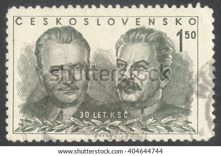 """MOSCOW, RUSSIA - CIRCA APRIL, 2016: a post stamp printed in CZECHOSLOVAKIA shows portrait of Gottwald and Stalin, the series """"The 30th Anniversary of Czechoslovak Communist Part"""" circa 1951 - stock photo"""