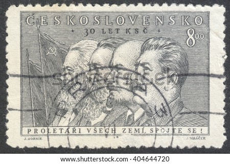 """MOSCOW, RUSSIA - CIRCA APRIL, 2016: a post stamp printed in CZECHOSLOVAKIA shows portrait of Marx, Engels, Lenin and Stalin, the series """"The 30th Anniversary of Czechoslovak Communist Part"""" circa 1951 - stock photo"""