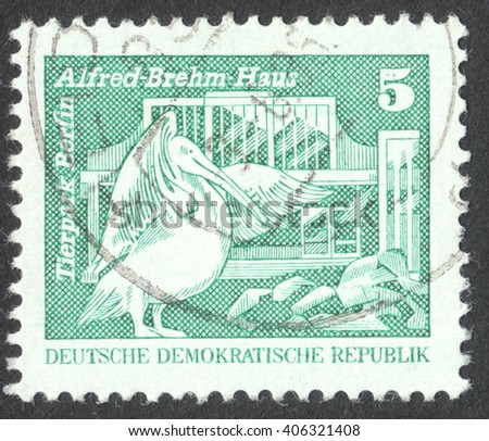 """MOSCOW, RUSSIA - CIRCA APRIL, 2016: a post stamp printed in DDR shows Alfred-Brehm-Building; Berlin Zoo - Rosy Pelican, the series """"Construction in the DDR"""", circa 1973 - stock photo"""