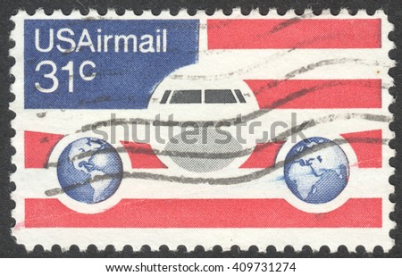 MOSCOW, RUSSIA - CIRCA APRIL, 2016: a post stamp printed in the USA shows a plane and globes, circa 1976 - stock photo