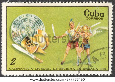 "MOSCOW, RUSSIA - CIRCA FEBRUARY, 2016: a post stamp printed in CUBA shows gladiators, the series ""World Fencing Championships, Havana"", circa 1969 - stock photo"