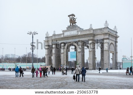 MOSCOW, RUSSIA - CIRCA JAN, 2015: The Propylaea is the central gate entrance in VDHKh area in Moscow. VDNKh is the all-Russian Exhibition Center with huge skating ring at winter season - stock photo