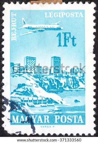 "MOSCOW, RUSSIA - CIRCA JANUARY, 2016: a stamp printed in HUNGARY shows a plane over Beirut, the series ""Cities and Airplanes"", circa 1966 - stock photo"