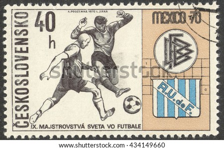 "MOSCOW, RUSSIA - CIRCA JUNE, 2016: a post stamp printed in CZECHOSLOVAKIA shows Two Players and Badges of Germany and Uruguay, the series ""Football World Cup - Mexico"", circa 1970 - stock photo"