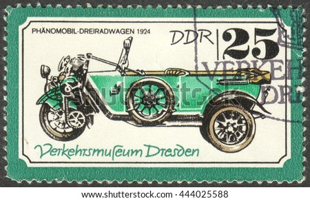 "MOSCOW, RUSSIA - CIRCA JUNE, 2016: a post stamp printed in DDR shows a phanomobil tricycle carriages, the series ""Transportation - Dresden Traffic Museum"", circa 1977 - stock photo"