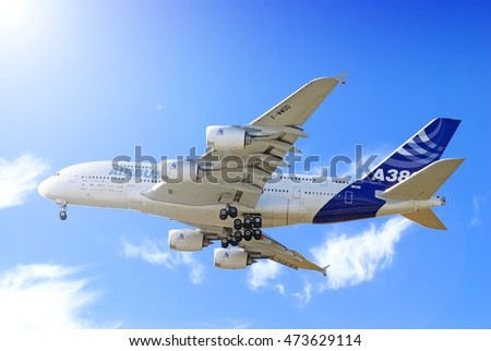 MOSCOW, RUSSIA - CIRCA OCTOBER, 2009: Airbus Industrie company EADS Airbus A380 wide body passenger airplane flying with landing gear extended against  blue sky detail aerial exterior panoramic view