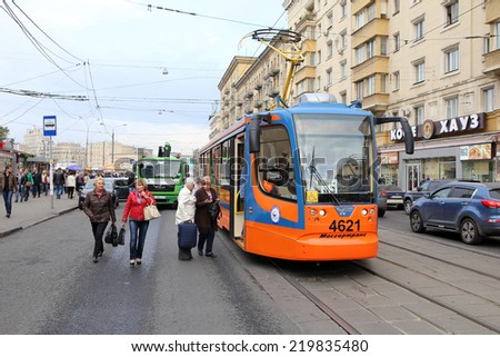 MOSCOW, RUSSIA, CIRCA 2014 - Passenger come into tramway of new model circa 2014 in Moscow, Russia