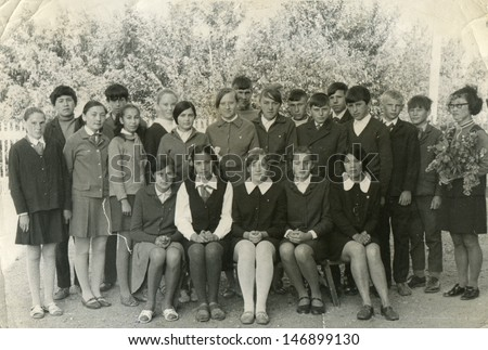 MOSCOW, RUSSIA, CIRCA 1960s: Antique photo, Group portrait of school graduates, circa 1960s - stock photo