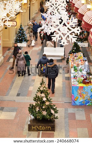 MOSCOW,RUSSIA - DEC 29,2014:GUM department store, located across Red Square, is welcoming visitors with decorations in heart of Moscow as city prepares for upcoming Christmas and New Year celebrations