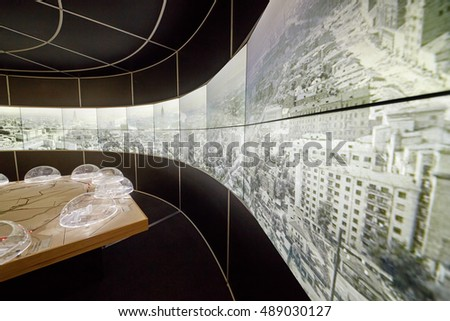 MOSCOW, RUSSIA - DEC 20, 2014: Scheme of Moscow ring railway stations on Moscow map and city panorama at VDNKH exhibition.