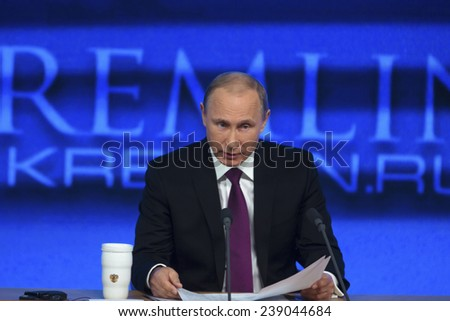 MOSCOW, RUSSIA - DEC 18: The President of the Russian Federation Vladimir Vladimirovich Putin an annual press conference in Center of international trade in Moscow on 18 of December 2014, Russia - stock photo