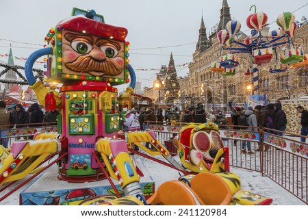 MOSCOW, RUSSIA - DEC 31, 2014: View of Christmas fair on Red Square near Main Department store (GUM)  on 31 December of 2014 in the center of Moscow, Russia - stock photo