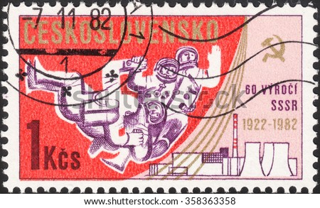 MOSCOW, RUSSIA - DECEMBER, 2015: a post stamp printed in CZECHOSLOVAKIA shows spacemen and devoted to the 65th Anniversary of October Revolution and the 60th Anniversary of the U.S.S.R, circa 1982 - stock photo