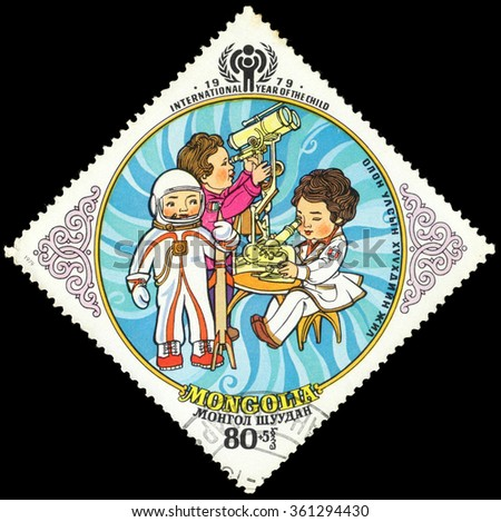"""MOSCOW, RUSSIA - DECEMBER, 2015: a post stamp printed in MONGOLIA shows playing children, the series """"International Year of the Child"""", circa 1979 - stock photo"""