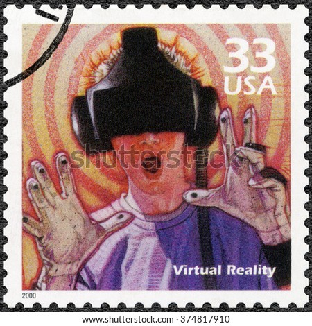 MOSCOW, RUSSIA - DECEMBER 28, 2015: A stamp printed in USA shows Man using virtual reality game, series Celebrate the Century, 1990s, circa 2000 - stock photo